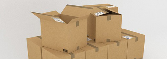 A photograph of stacked cardboard boxes to represent moving office